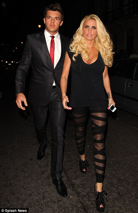 Leggy Katie Price hits the town with Leandro... but all eyes are on her tattoo