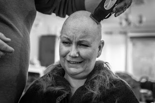 My Husband shaving my head due to Breast cancer treatment