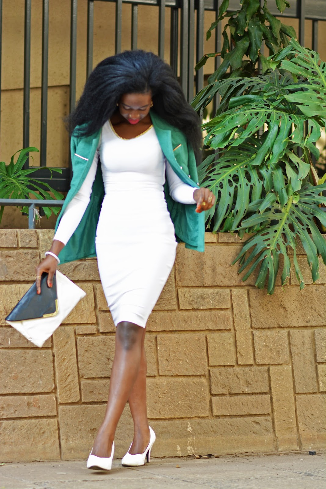 Style with ezil, Ezil, Africn fashion blogger, Kenyan fashion blogger, Green trench , white bodycon dress, what to wear on a chill day, how to style a dress in the cold season.