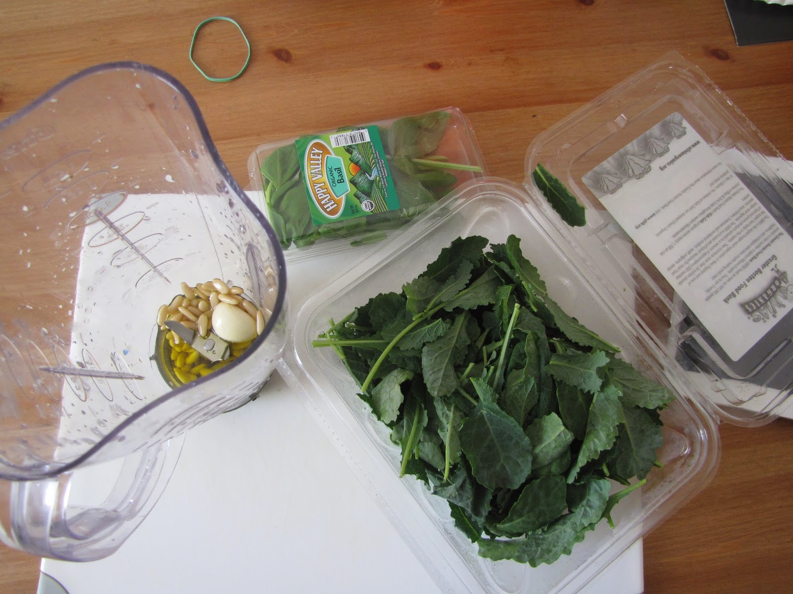 Baby Kale, Pine nuts, Olive oil, garlic and basil for a pesto about to be blended
