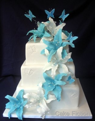 A new twist on a classic three tier square white wedding cake