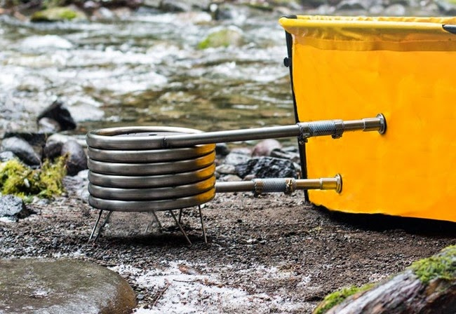 It uses a water heater coil to get the water hot. Firewood will help get the heater going, but you can also use propane. - This Camping Accessory Is The Best Invention Ever, You'll Be So Jealous