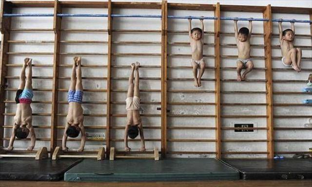الصين وكيفية صناعة الأبطال الألومبيين China-gymnasium-Olympic-children-31