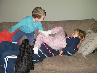 2 children and a dog beating up an adult