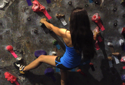 Sabrina Torrest climbing at Aiguille Rock Climbing Center