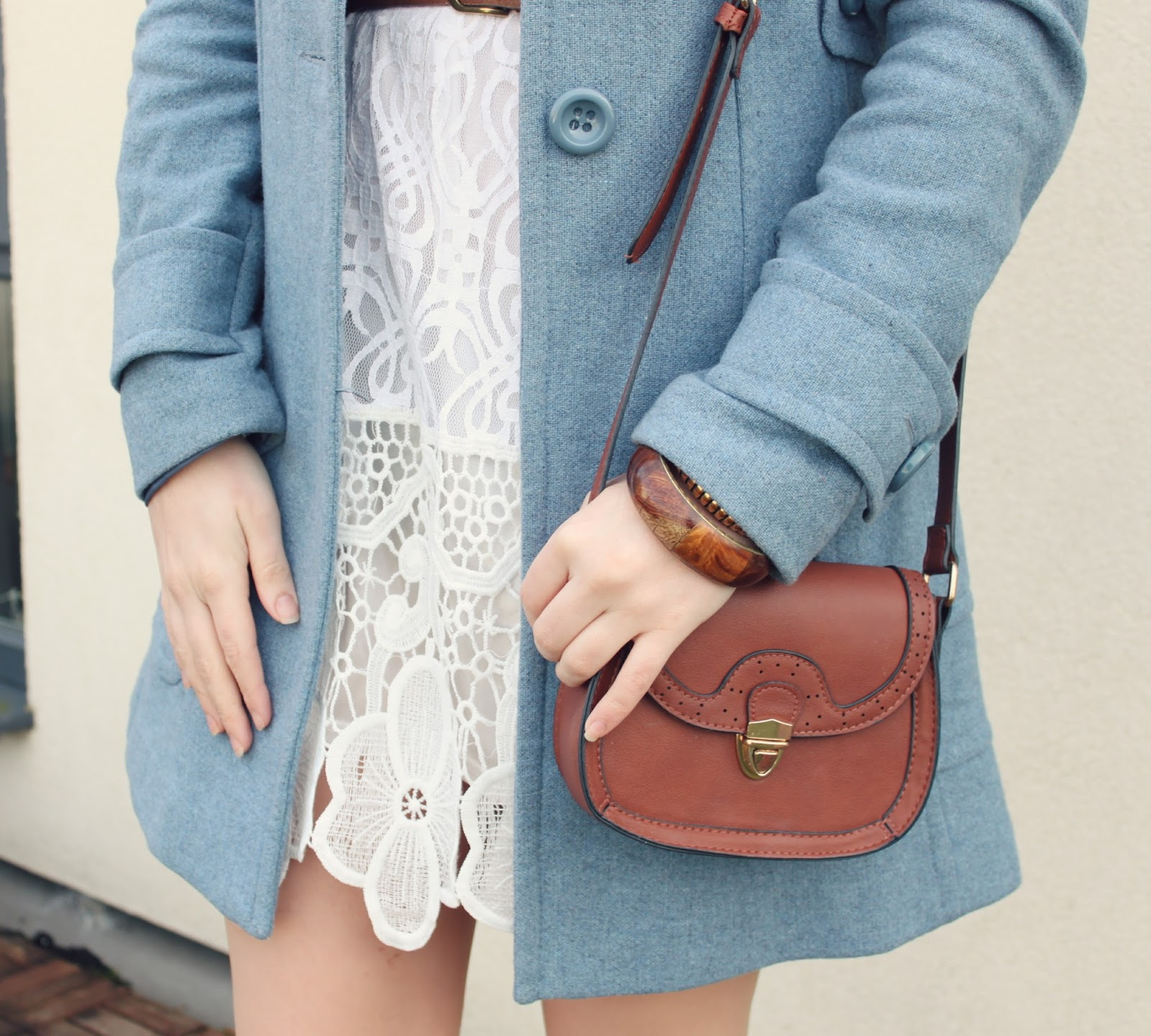 brown-bag-against-pastel-blue--coat