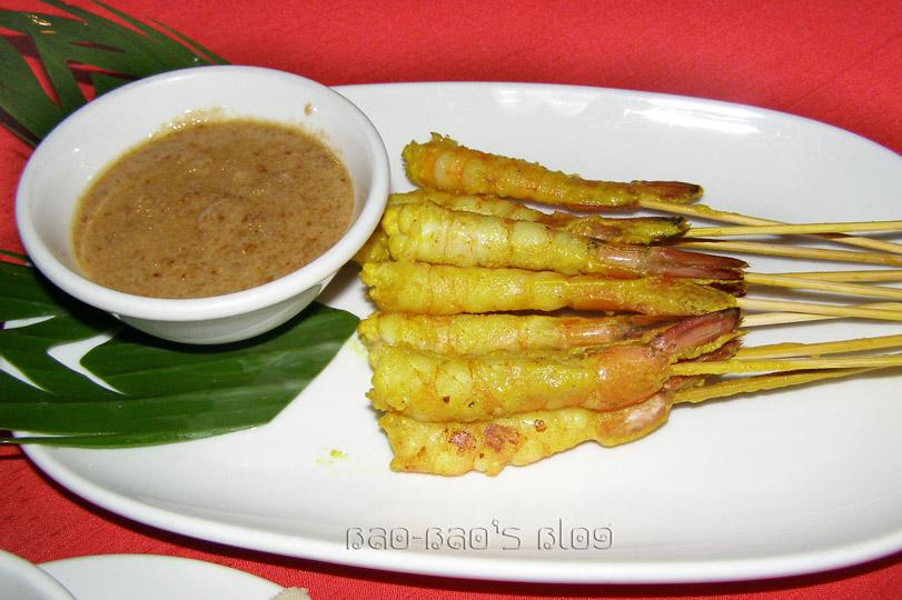 Shrimp satay with a peanut dipping sauce.