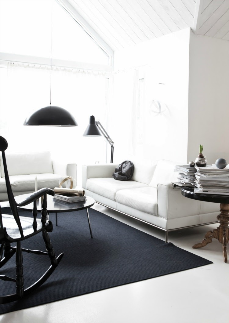White minimalist living room with black accents