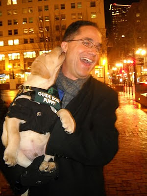NBC Chief Meteorologist Matt Zaffino holds Guide Dog puppy-in-training Zaffino