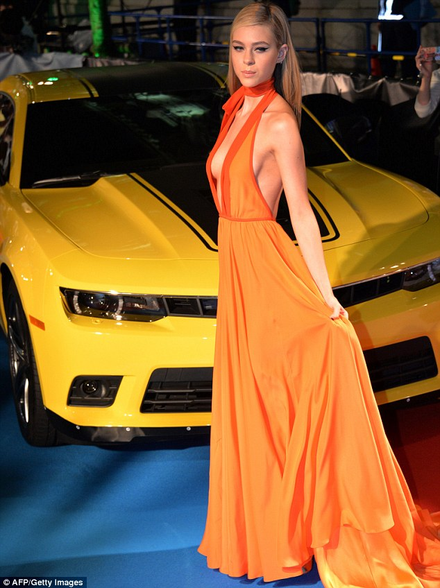Nicola Peltz goes braless in an orange gown at the 'Transformers: Age of Extinction' Tokyo premiere