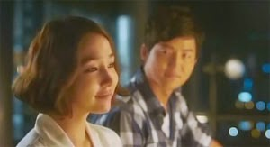 Lee Jae Ik gazes at Shin Jin A on the balcony.