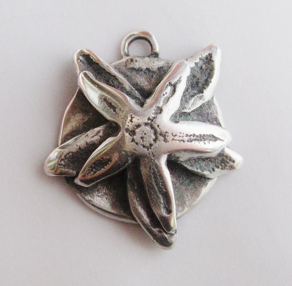 http://wingedwomanart.3dcartstores.com/Poseidons-Bride-starfish-necklace-with-paua-shell_p_33.html