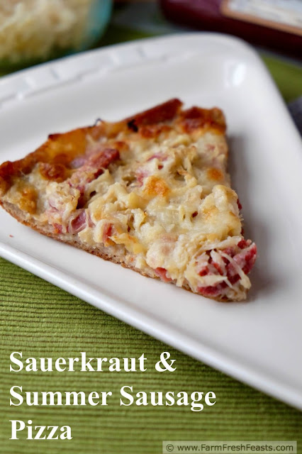 Ball park flavors in a home made pizza. This pie takes the sausage & sauerkraut combo and tops it with smoked mozzarella for a new twist on pizza night.