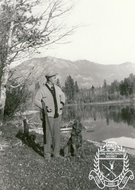 A.M. Chisholm out hunting with his dog