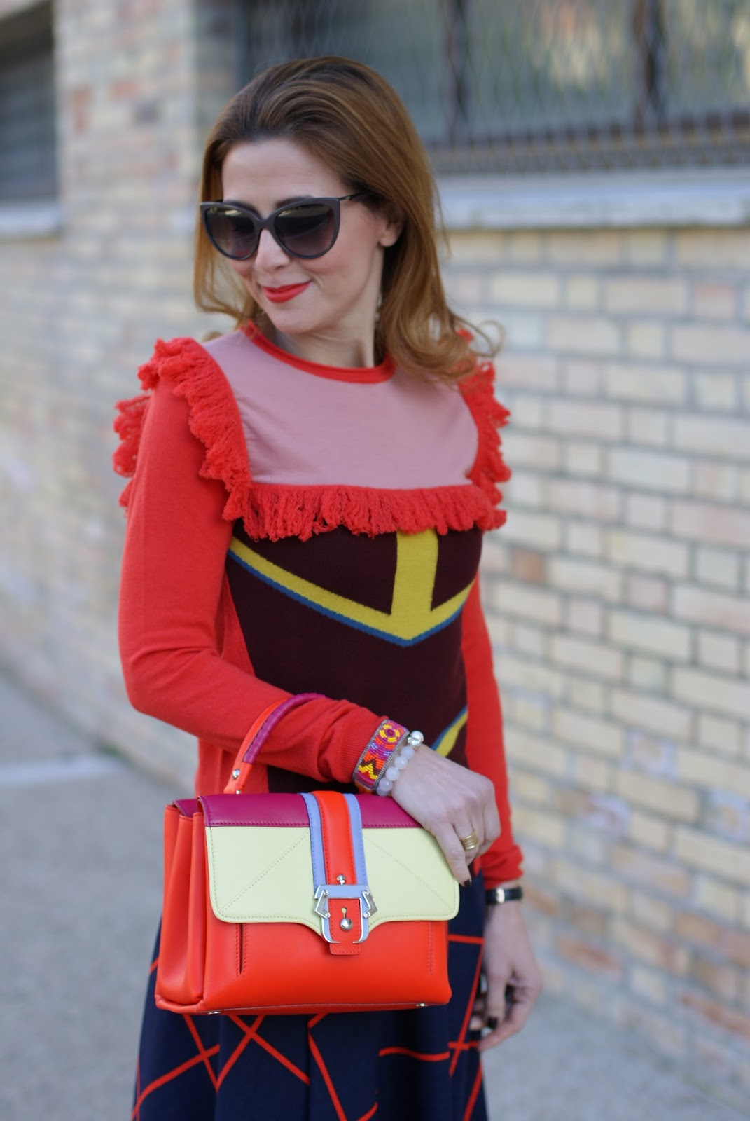 Lazzari fringed sweater and Paula Cademartori Petite Faye bag on Fashion and Cookies fashion blog, fashion blogger style