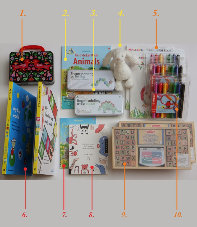 presents in my present cupboard stash include finger printing kits, rubber stamp kits, okido books, cappi pens and colouring books