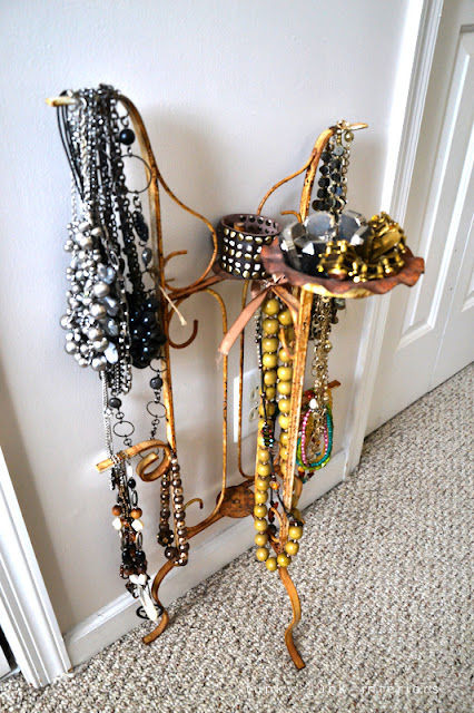 Snooping inside junker Bella Rustica Linda's house via Funky Junk Interiors - rusty jewelry holder