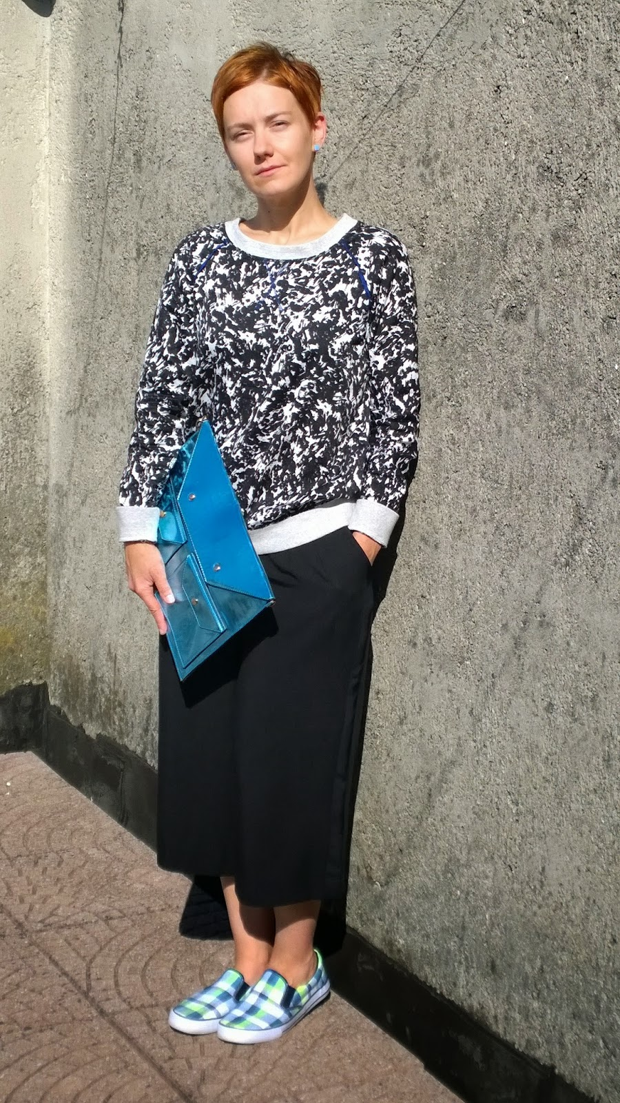 plaid pattern shoes, blue metallic clutch, black & white splash pattern sweater, culottes