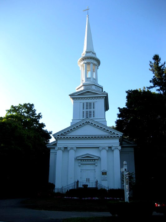 White church with tall steeple.