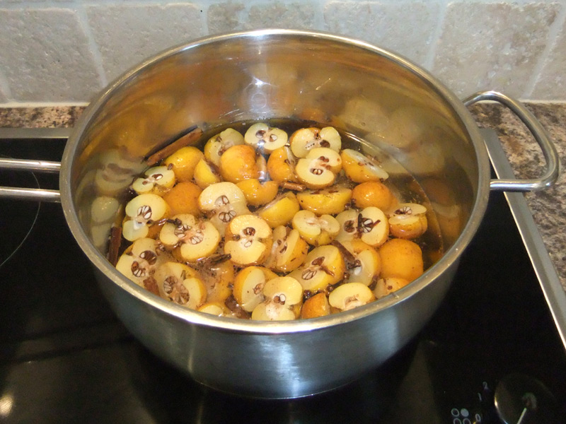 Stewing the halved crab apples and spices