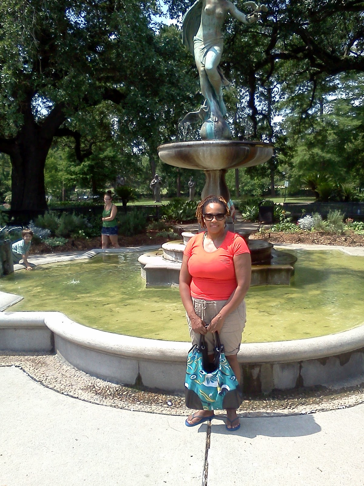 SkychiTravels in front of a fountain at Audubon Park
