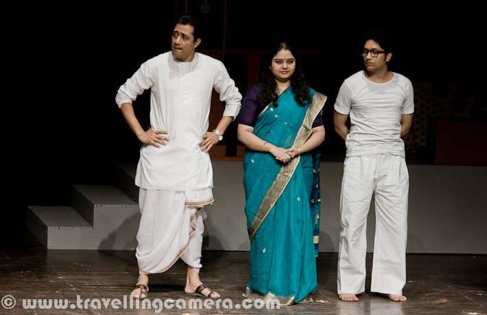Byomkesh play was performed at 14th Bharat rang Mahotsav 2012. It was one of the exciting plays of Bharangam 2012. It was performed in Kamani and whole auditorium was full of audience from various parts of the country. Let's have a quick Photo Journey of Byomtesh, a Bengali play with English subtitles...Inspired by the fictitious character of Sherlock Holmes, Byomkesh Bakshi was created as the intelligent, mystery-loving and mystery-solving detective of Bengali literature. And most of the folks also relate to Byomtesh as one of the popular Indian Detective, who was seen many times on Doordarshan-1. This is one of the TV-Serials, our generation has seen on DD-1. During childhood Byomkesh was one of the hero and now if we see some of the episodes, it looks like a comedy serial. This play was on same lines, but there were few things which were seriously taken care of.Play starts with a phone call to Byokesh that an old man of a family has been found dead with some odd things happening in the family. At the same time police has started the investigations around the case. There was a very common thing in all Byomkesh episodes on Doordarshan and Police used to give some non-sense reasoning. And Byomkesh always used to think differently. Same thing happened in this play as well. police Inspector was interesting and delivered some of the humorous dialogs brilliantly. There were some flash-back scenes in this play. Above scene was shown when Police Inspector was asking questions from home servant in that house. He is in flash-back and thinking of conversation between him and his Boss, who is not alive now.Similar to Holmes who had his companion in Watson, Byomkesh also cultivates the friendship of Ajit Bandhopadhyay who is his perennial fellow adventurer on his quest to solve mysteries and murders. Holmes and Byomkesh had one major difference - the former was disinterested in women and stayed a bachelor, while Byomkesh meets his life-partner Satyabati and eventually marries her. See the photograph below, which is a conversation about investigations but expressions of Byomkesh can interpreted in two ways...Here Byomkesh is interrogating one of the lady in house and she has few things missing from her room. Initially she was very comfortable and denied of any change in her room. But later it came out that a needle was missing from her room, which was found near Dead-body. Let me stop here as I am not supposed to share exact story here.One of the family-member was fond of Sitar and most of the times he can be found on it. He was handicapped and looked someone who is more into reading, music & happy to be alone.After all interrogation sessions with different Family Members and more information from outside sources, Byomkesh reaches to final culprit and he accepts his fault. Above photograph shows the scene when Byomkesh is explaining everything about the case.Finally Byomkesh also fallen in love with the girl from same house and here is a photograph clicked during end of the play.Here are some of the Theatre Performers in Bengali Play BYOMKESH, during 14th Bharat Rang Mahotsav 2012. They are with one of the typical action/posture/style, which they portrayed in this play.The play Byomkesh presents the life and times of one of the greatest fictitious character of crime thrillers. It unveils the mysteries, intricacies and compulsions, motives and hidden agendas of human relationships and simultaneously throws light on the baser instincts as well as the higher aspirations and values of human beings.Bratya Basu standing on Kamani Stage with his crew of Byomkesh after successful completion of the performance during 14th Bharat Rang Mahotsav 2012.This play was in Bangla and English subtitles were being shown on top of the stage. At times, Bangla dialogs were so fast that it was extremely difficult to read the dialogs written in English. Since there were lot of Bengali folks in the ground to help us in making sure that we laugh when required :) ... Anyway, play was full of laughter with interesting punches in between.Emmanuel Singh and Rajni from National School of Drama, who are facilitating post play ceremony of presenting flowers and momento of 14th Bharat Rang Mahotsav to Director and Team of Byomkesh play.Subhrajit Dutta, who is standing in the middle, played the role of Byomkesh Bakshi in this play. Some of the more details about this role in Bratya Basu's Byomkesh, check out http://articles.timesofindia.indiatimes.com/2011-02-22/news-interviews/28625059_1_byomkesh-bakshi-stage-roleHere was a quick PHOTO JOURNEY from Byomkesh play during 14th Bharat Rang Mahotsav 2012 at Kamani Auditorium. This festival is being organized by National School of Drama, Delhi with support from Minitry of Culture. 22nd, which means today is last day of this festival and I will eagerly be waiting for NSD Repretory's Summer Theatre Festival 2012.