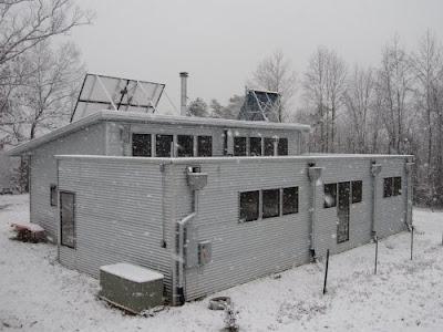 Off grid passive solar prefab home surfs sun to snow for Passive solar prefab homes