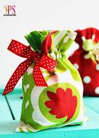 Embalagens de tecido para presentes de natal
