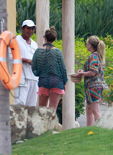 Hilary & Haylie Duff talking to someone