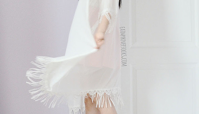 Close-up on the flowy boho-chic hem on SheIn's longline tassel fringed kimono cardigan.