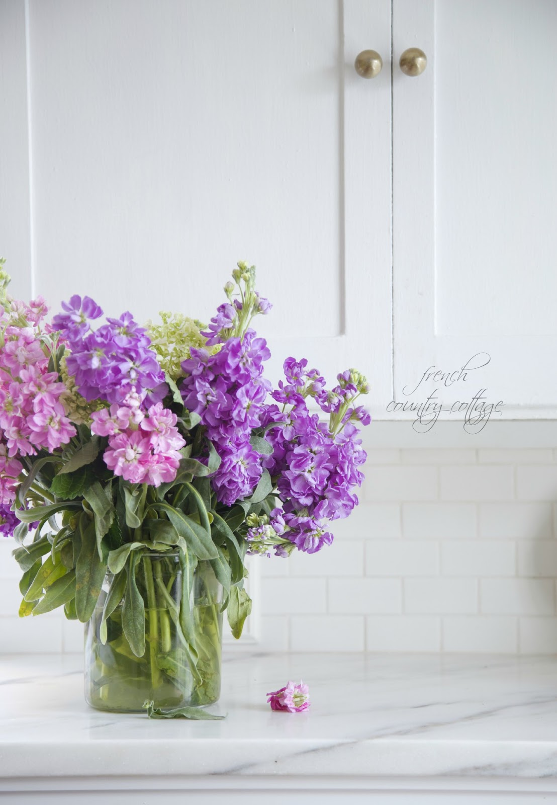 Courtney at french country cottage decorated the kitchen - Marble Counter And Subway Tile Backsplash In Cottage Kitchen