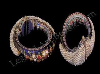 Kundan set diamonds on a translucent blue enamel ground; a meshwork of seed pearls on top.