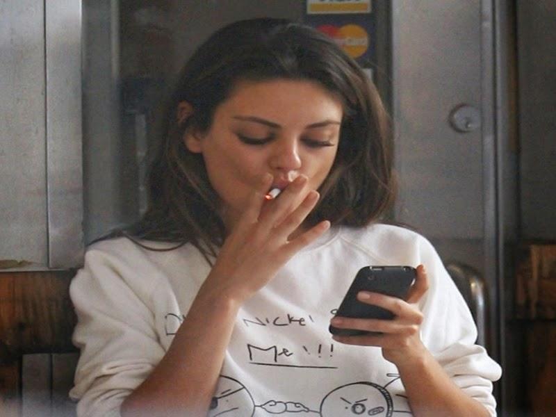 mila kunis smoking