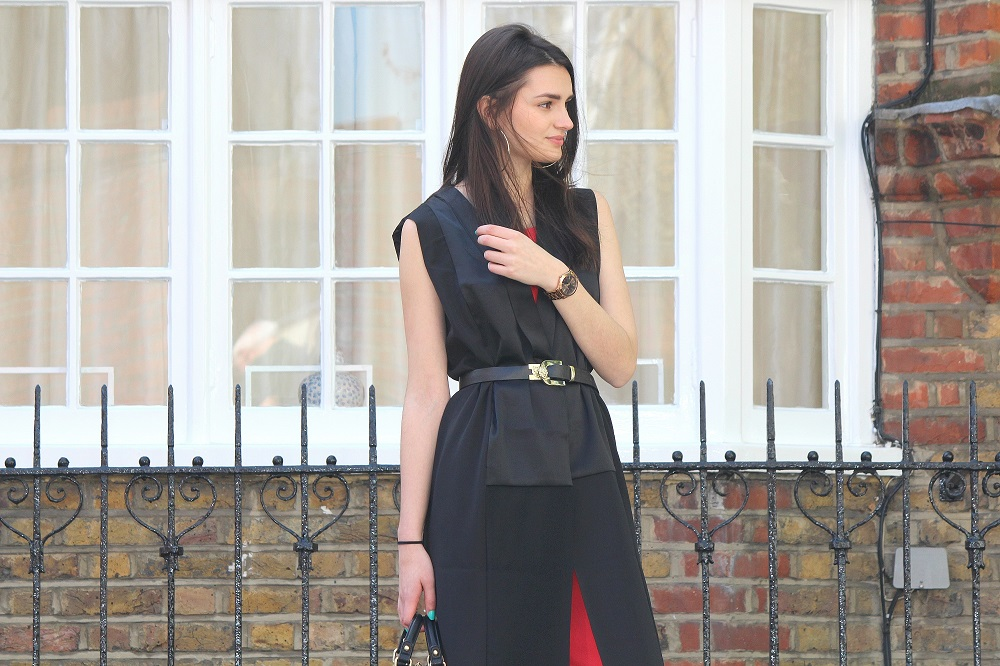 peexo fashion blogger wearing culotte jumpsuit and sleeveless blazer and black belt in spring