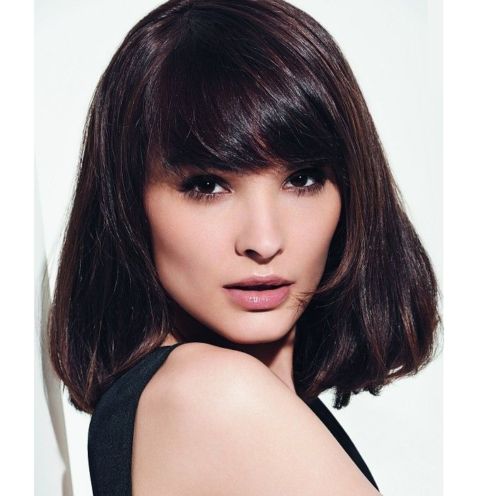 medium length hairstyle with side blunt bangs