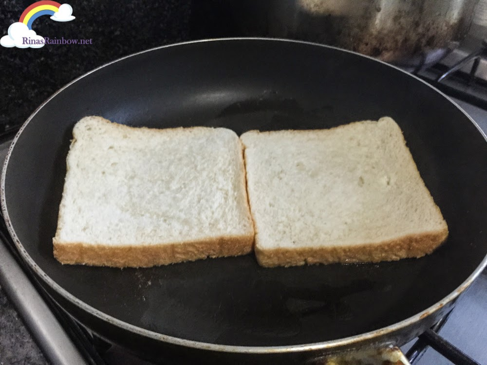cooking grilled cheese sandwich