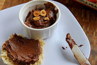 nutella in a white bowl and spread on an english muffin
