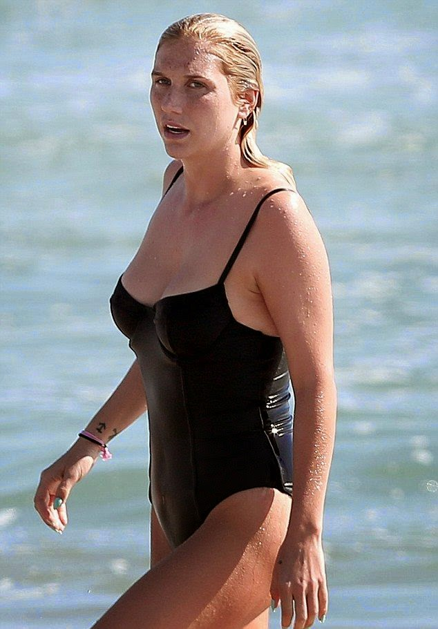 If you are the kind of people who likes forfeiting glamour when you hit the seashore, a one-piece idea like Kesha's amazing for you. And for the rest of us, the options we've found are so excellent as the singer showed off her killer body in a black swimsuit in California, USA on Friday, September 5, 2014.