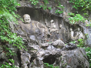 A carving of the Laughing Buddha on Flying Peak, near Lingyin Temple, Hangzhou