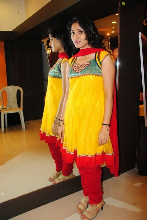 Lalitya in Yellow Sleeveless with Anarkali with Red Odhni