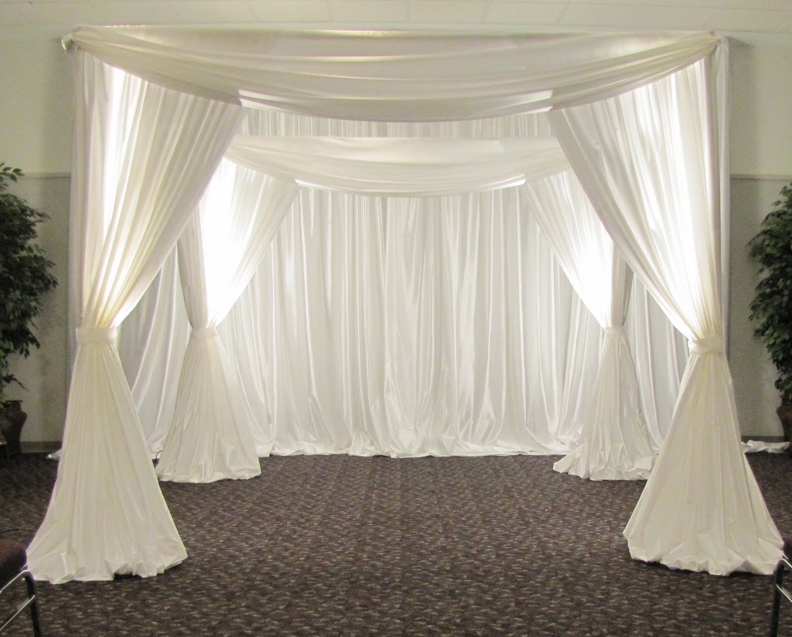 Party people event decorating company wedding chuppah for Back ground decoration