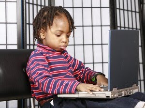 Little Kid Using Computer