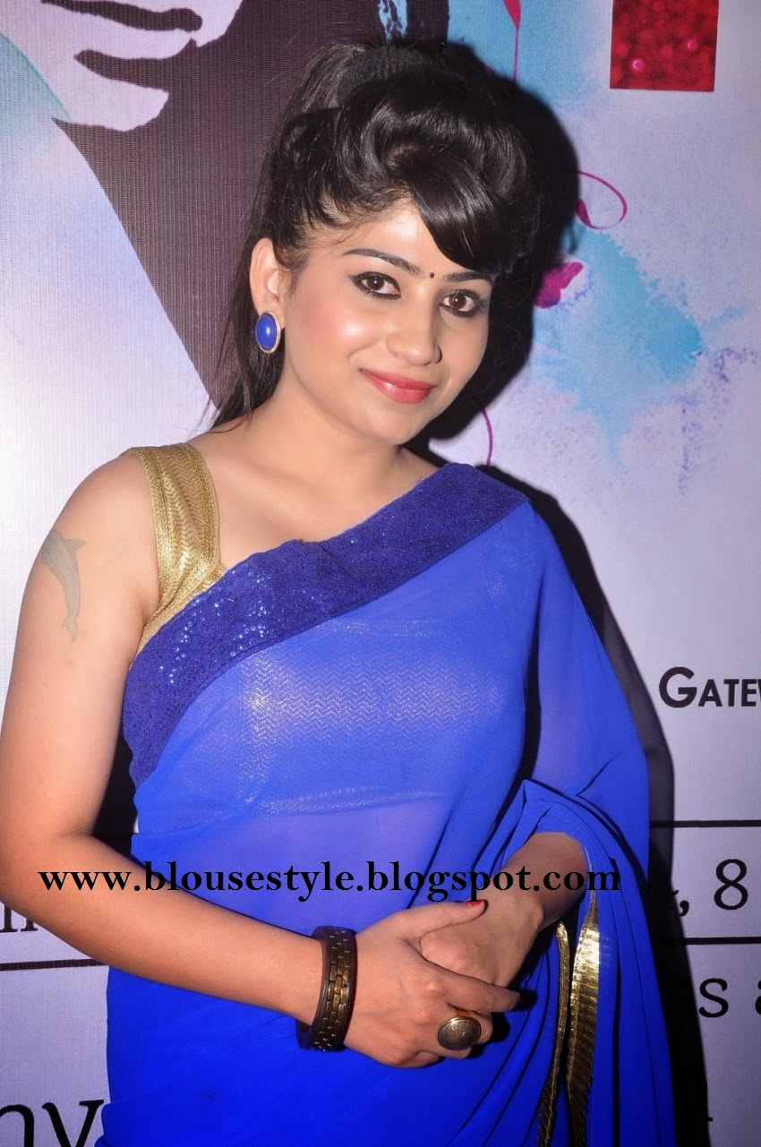 Gold color sleeve less blouse with ink blue saree
