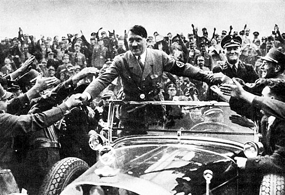 a look at the political career and rise of adolf hitler to power Explore the life of benito mussolini, including his rise to power and how his quest to bring  as italy slipped into political  world war ii and adolf hitler.