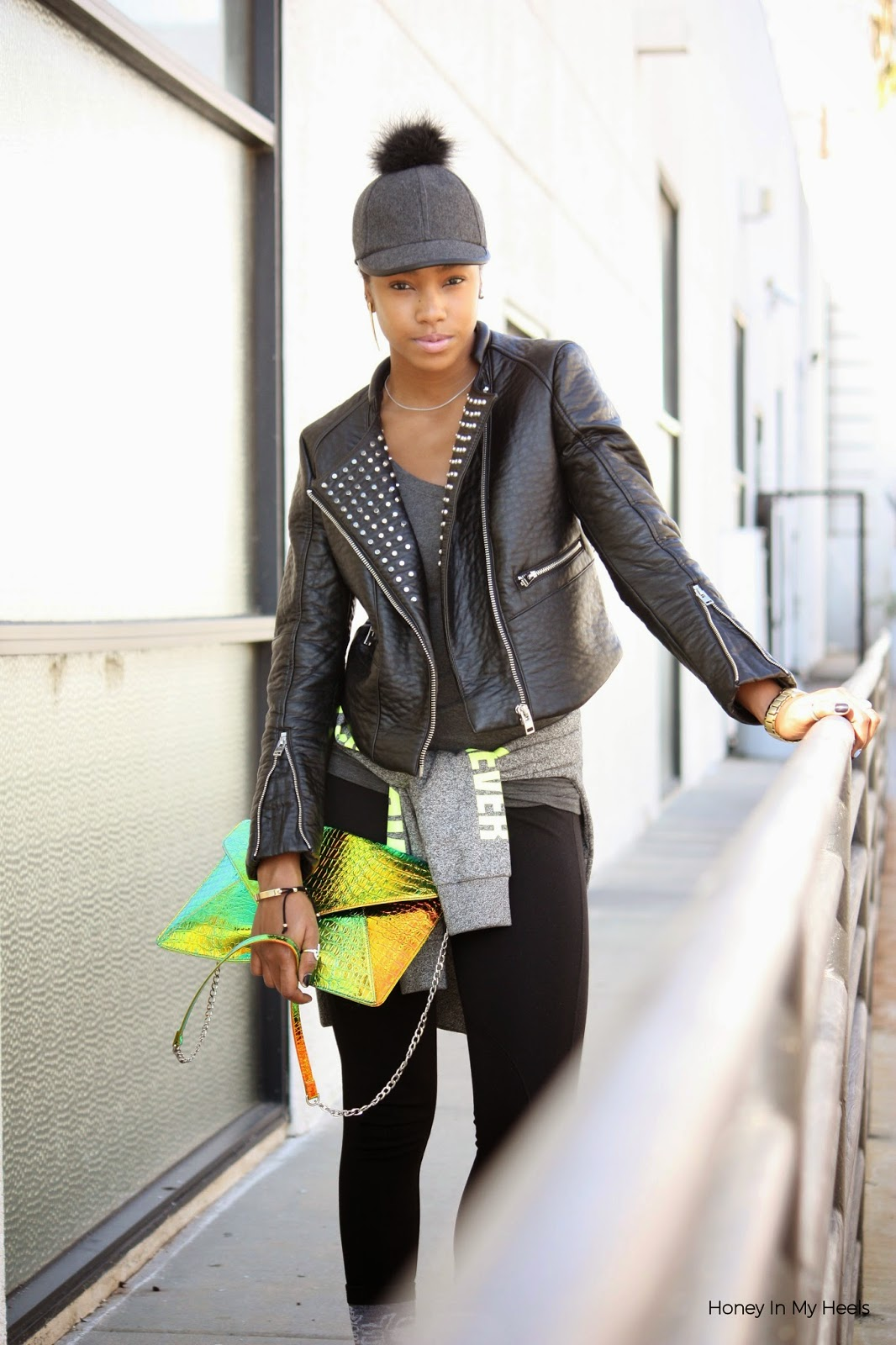 Marquise C Brown fashion blog Honey In My Heels wearing BCBGeneration pom pom baseball cap H&M faux leather studded jacket and Nasty Gal crossbody bag