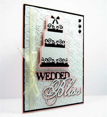 http://www.capadiadesign.com/2012/08/wedded-bliss-card-makeover.html#.UyqCkIVwU08