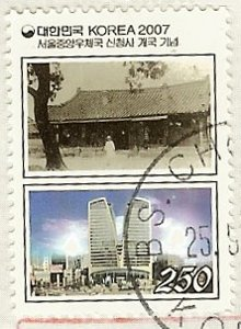 stamp showing old and new post office buildings
