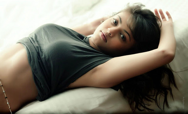 Actress Sneha Ullal Posing in Grey top and Short Skirt on Staircase