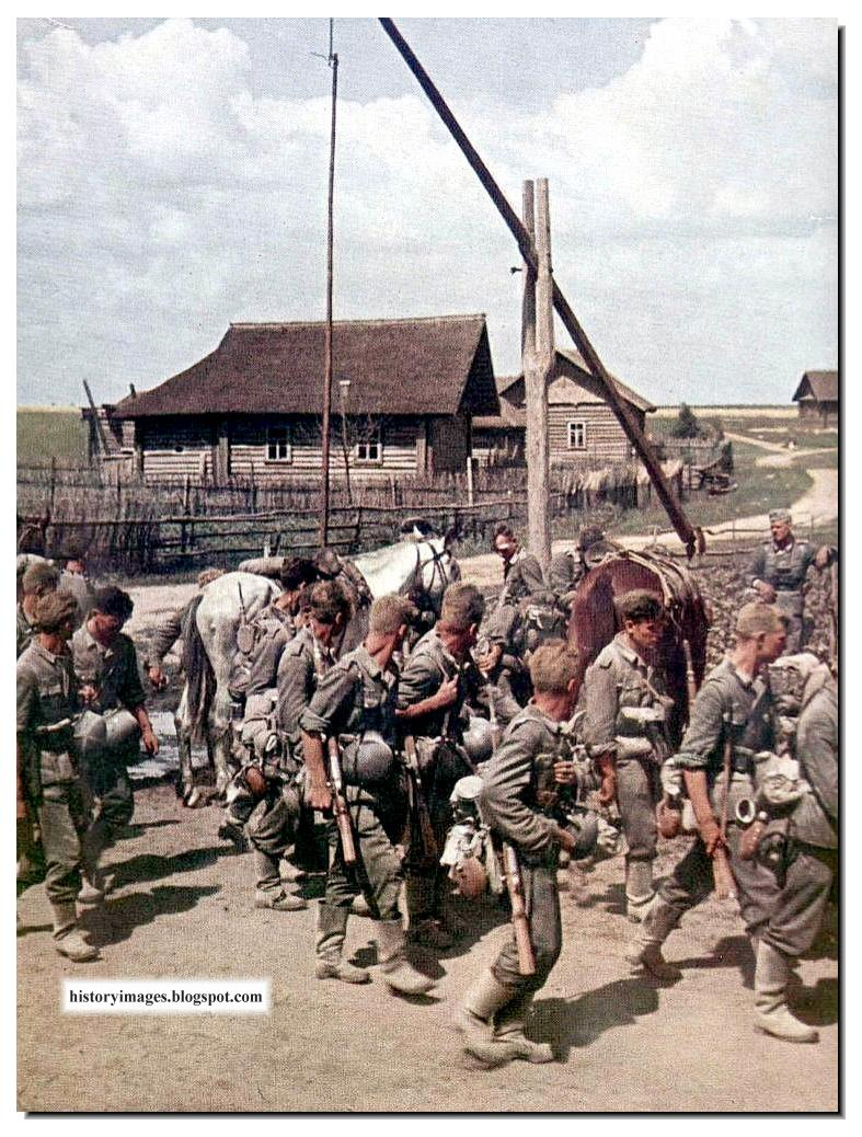 german soldiers Civilians join german soldiers on their first mile's march towards paris  german soldier standing next to a giant rail gun shell  world war i tank.