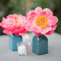 Turquoise Vases with Pink and Orange Flowers
